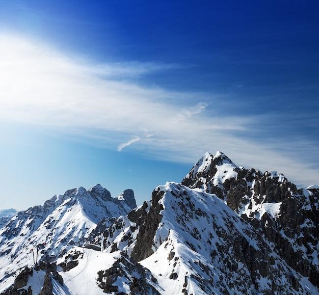 Beautiful landscape with snowy mountains. blue sky. horizontal. alps, austria. Free Photo