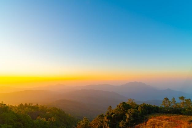 Beautiful layer mountain with twilight sunrise sky Premium Photo