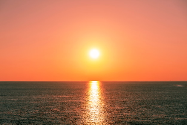 Beautiful light sunset or sunrise over sea scenery nature background Premium Photo