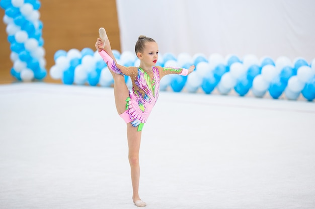 Beautiful little active gymnast girl with her performance on the carpet Premium Photo