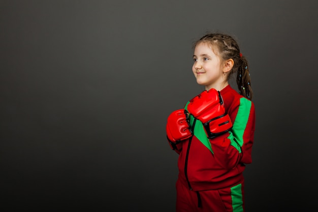 Beautiful little girl boxer in gloves ready to fight. Premium Photo