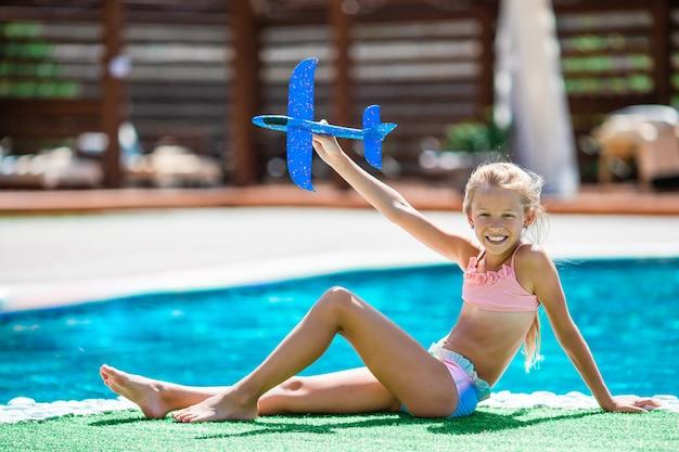Beautiful Little Girl Having Fun Near An Outdoor Pool Premium Photo