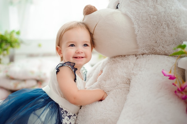 Beautiful little girl with toy smiling at the camera Premium Photo