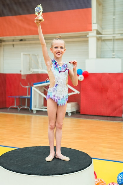 Beautiful little gymnast training on the carpet and ready for competitions Premium Photo