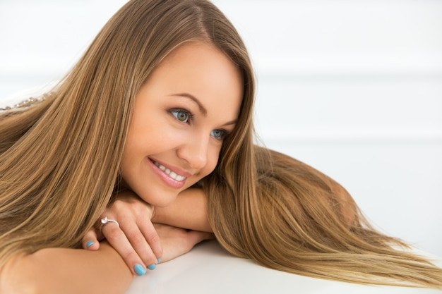 Beautiful long hair girl smiling Free Photo