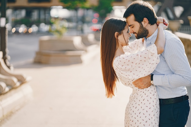 Beautiful long-haired girl in summer dress with her handsome husband Free Photo