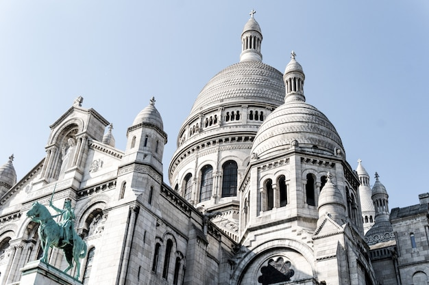 Beautiful low angle shot of the famous sacre-coeur cathedral in paris, france Free Photo