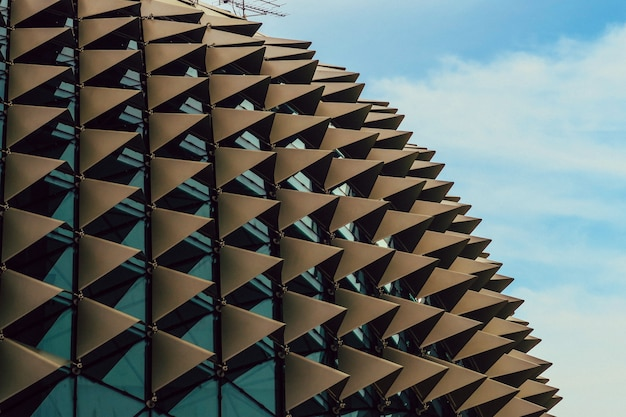 Beautiful low angle shot of a spiky modern architecture in an urban city Free Photo