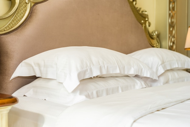 Beautiful luxury comfortable white pillow on bed decoration in bedroom Free Photo