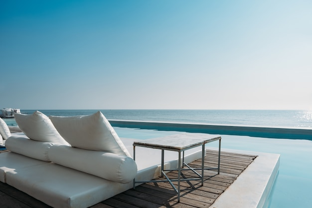 ab7663001d Beautiful luxury swimming pool on sea view and beach chair in hotel ...