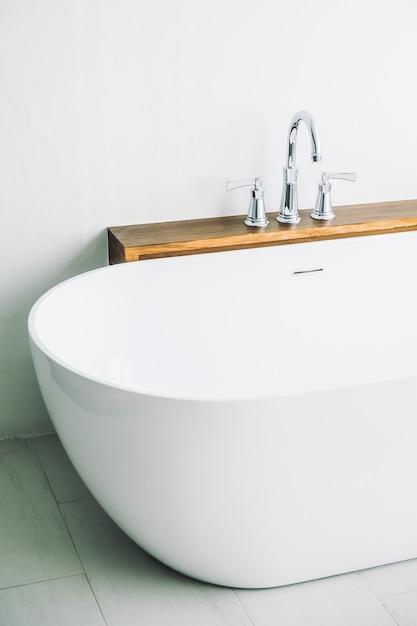 Beautiful luxury white bathtub decoration Free Photo