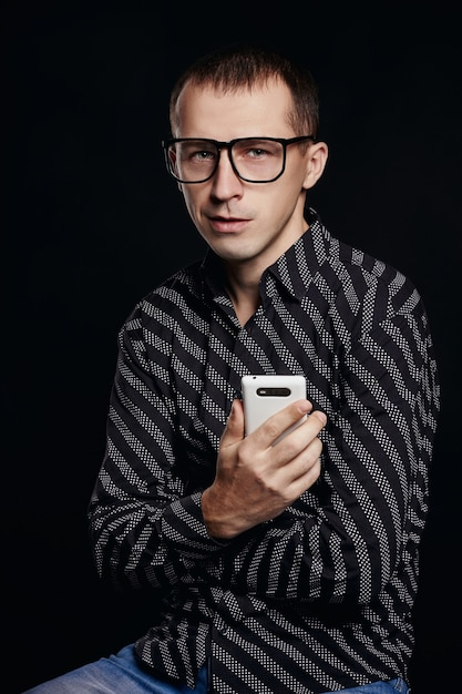 Beautiful male portrait on black Premium Photo