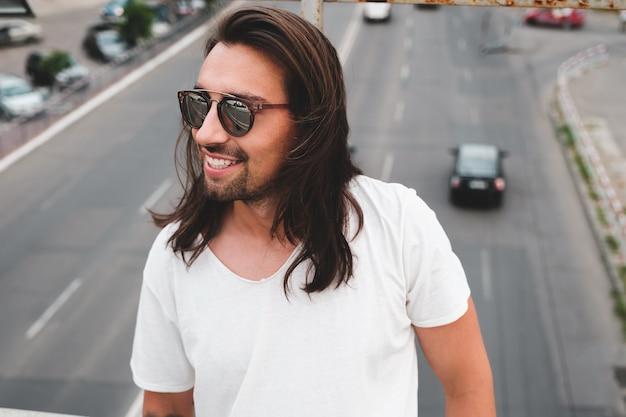 Beautiful man portrait wearing stylish sunglasses Free Photo