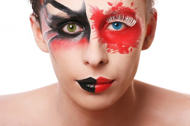 Beautiful man with abstract make up on white Free Photo