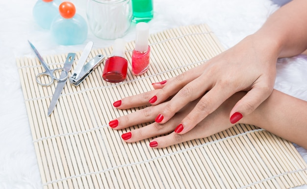 Beautiful manicured woman's nails with red nail polish Premium Photo