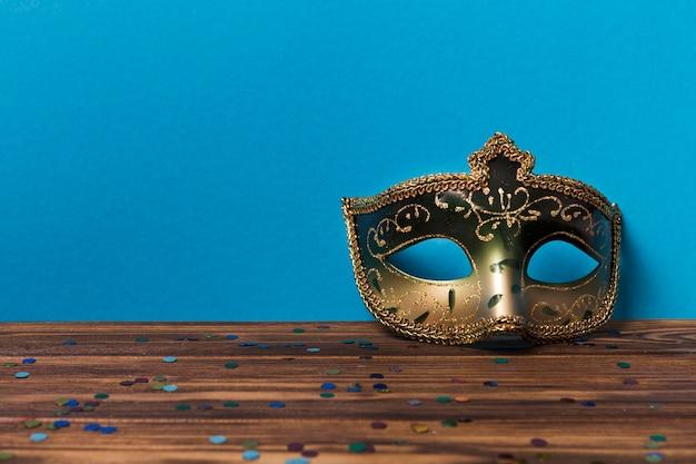 Beautiful mask near blue wall Free Photo
