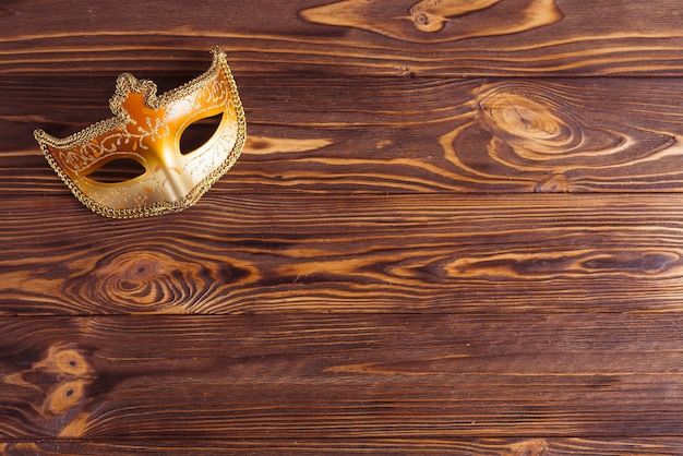 Beautiful mask on wooden table Free Photo