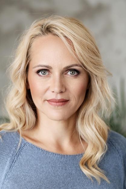 Beautiful mature blonde woman portrait | Free Photo