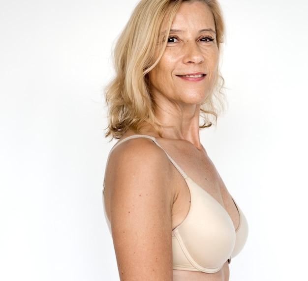 Beautiful Mature Woman In A Nude Bra Premium Photo