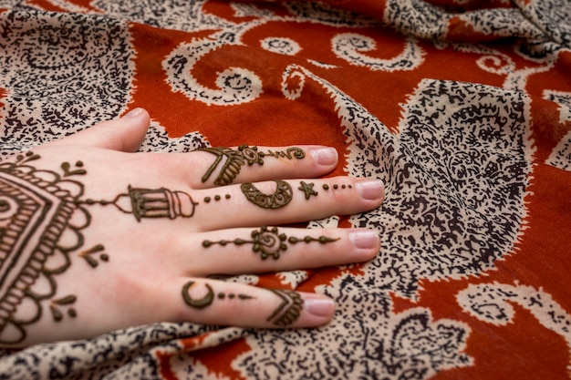 Beautiful mehndi tattoo on woman hand Photo
