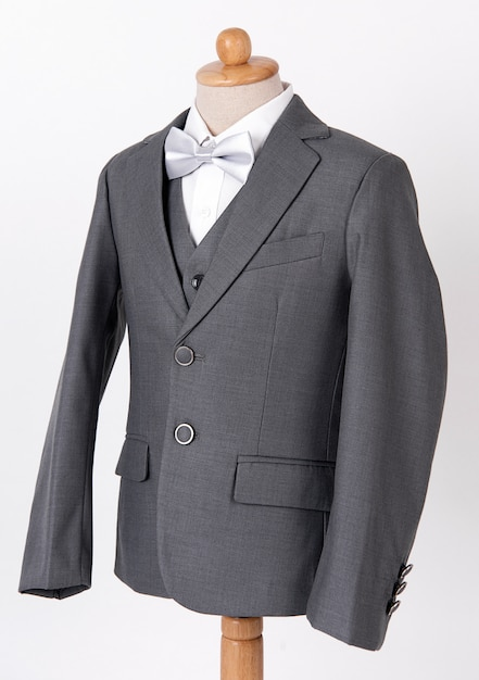 Beautiful men's grey jacket suit with shirt and bow tie on white background. Premium Photo