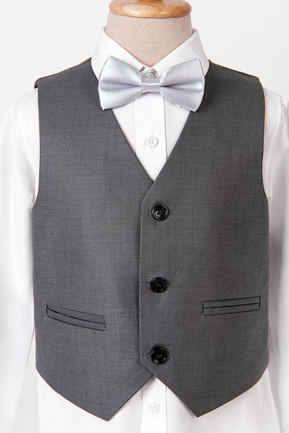 Beautiful men's grey suit with shirt and white bow tie. Premium Photo