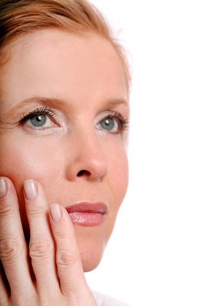 Beautiful middle age woman touch her face Free Photo