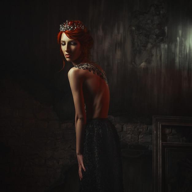 Beautiful Model Wearing Creative Body Art Dress Is Posing In A Dark Studio Premium Photo
