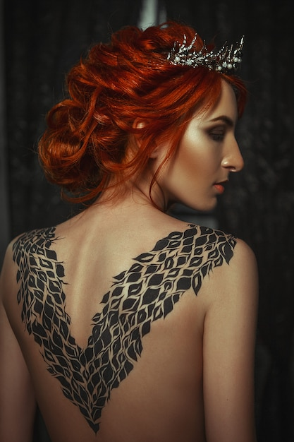 Beautiful Model Wearing Creative Body Art Dress Is Posing In A Dark Studio Premium Photo