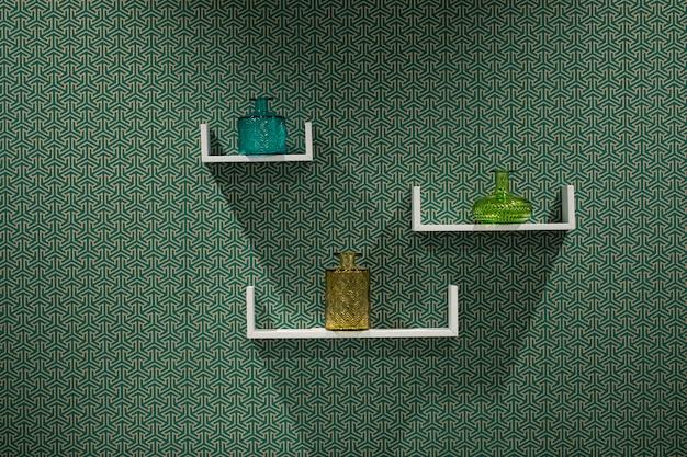 抽象的な壁に美しいモダンな3つの白い棚。 無料写真