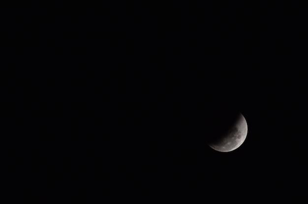 Beautiful the moon eclipse black background night at thailand 2018 Premium Photo
