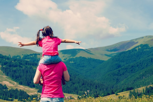 Beautiful mother and daughter on the mountain Premium Photo