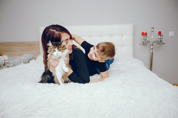 Beautiful mother with cute son at home Free Photo