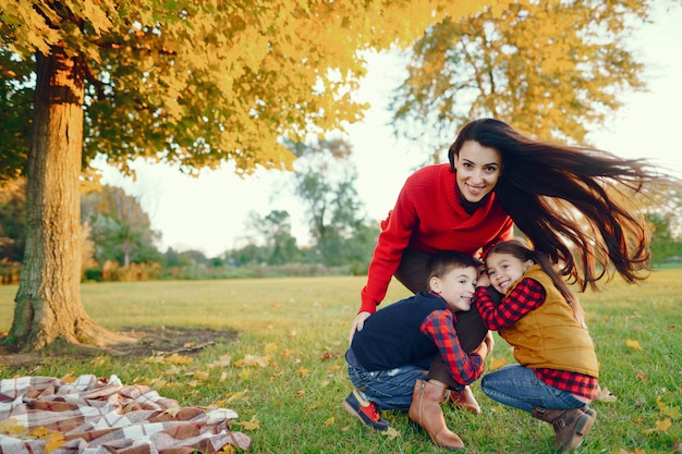 Beautiful mother with little kids Free Photo