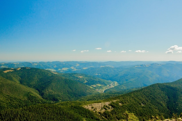 Beautiful mountain landscape, with mountain peaks covered with forest and a cloudy sky. ukraine mountains, europe Premium Photo