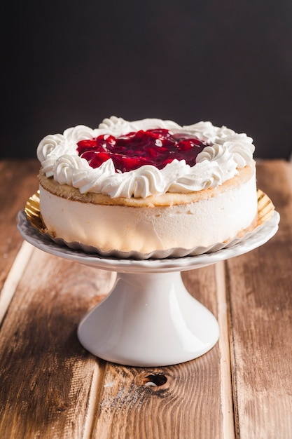 Beautiful mousse tart with cherry jam Free Photo