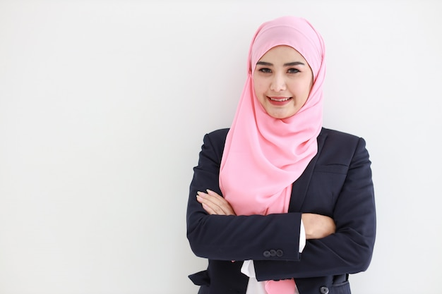 Beautiful muslim young asian woman wearing blue suit smiling confident . Premium Photo