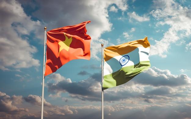 Красивые национальные государственные флаги вьетнама и индии вместе Premium Фотографии