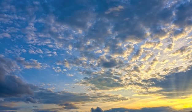Beautiful natural sunset or sunrise with the bright setting sun breaking through the clouds Premium Photo
