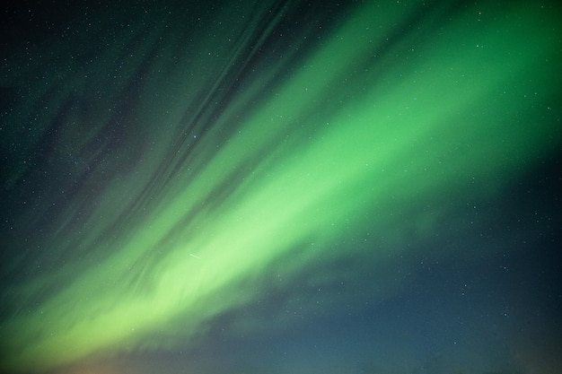Beautiful northern lights, aurora borealis dancing on night sky Premium Photo