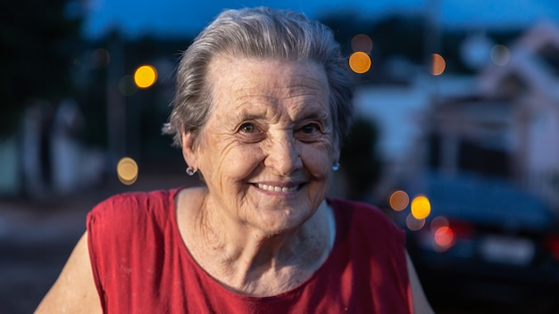 Beautiful older woman laughing and smiling. smiling elderly woman. Premium Photo