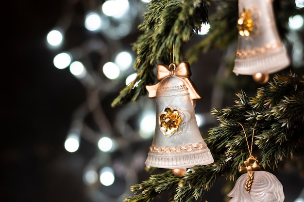 Beautiful ornaments in christmas tree close-up Free Photo