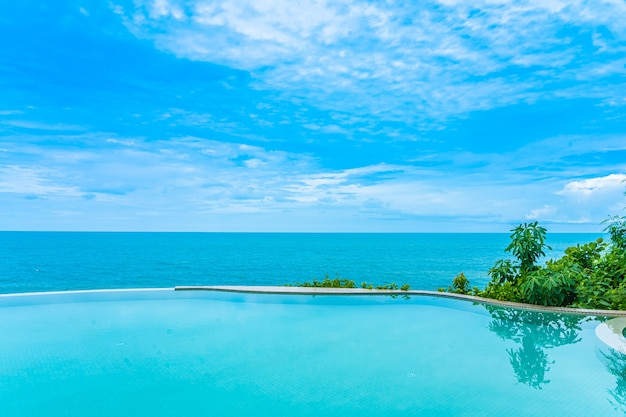 Beautiful outdoor infinity swimming pool with sea view Free Photo