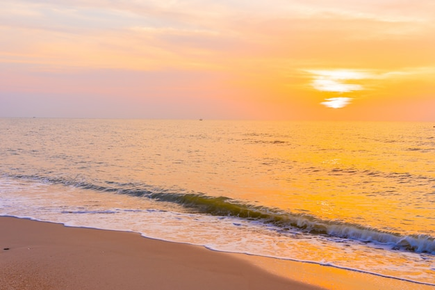 Beautiful outdoor landscape of sea and tropical beach at sunset or sunrise time Free Photo