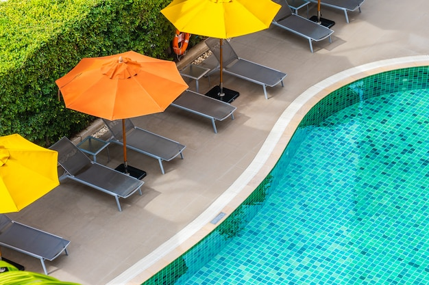 Beautiful outdoor swimming pool in hotel resort for holiday vacation Free Photo
