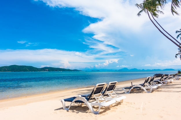 Beautiful outdoor view with umbrella and chair on the beach and sea Free Photo