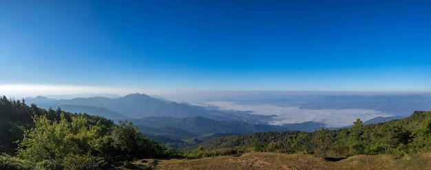 Beautiful panoramic mountain and mist on blue sky background , at north thailand  inthanon national park , chiang mai province , panorama landscape thailand Free Photo