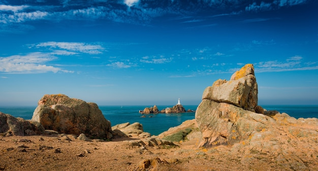 Beautiful panoramic shot of cliffs with a calm sea Free Photo