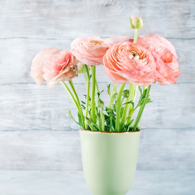 Beautiful pink ranunculus bouquet. woman mother's day wedding. holiday elegant bunch of flowers. Premium Photo