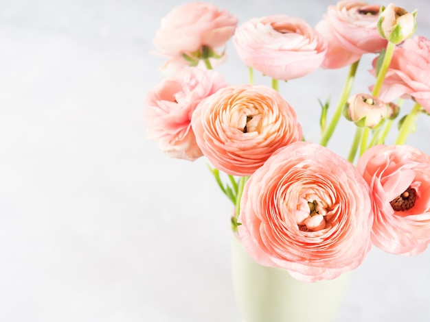 Beautiful pink ranunculus bouquet. woman mother's day wedding. Premium Photo